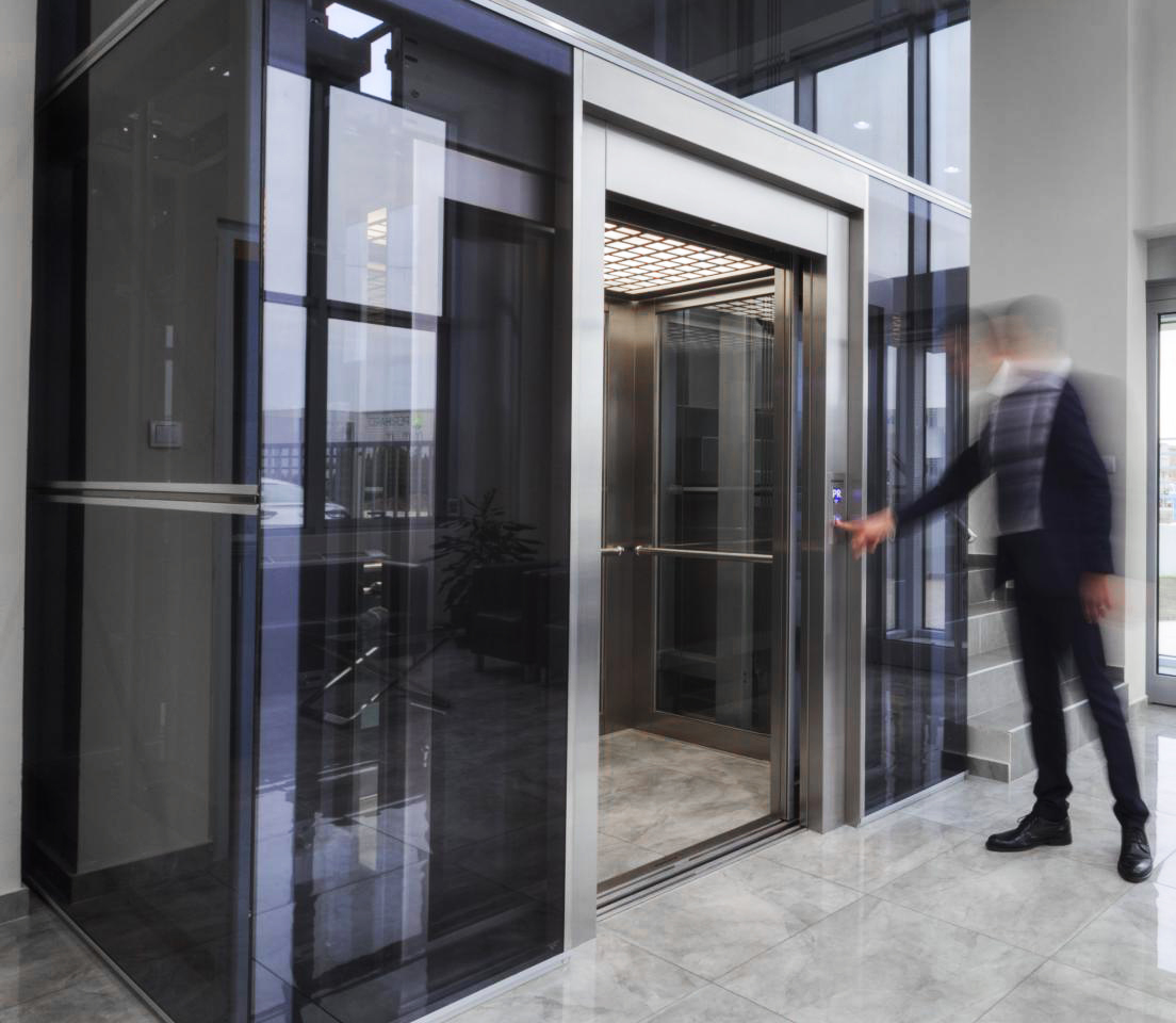 Person pressing call button on commercial lift